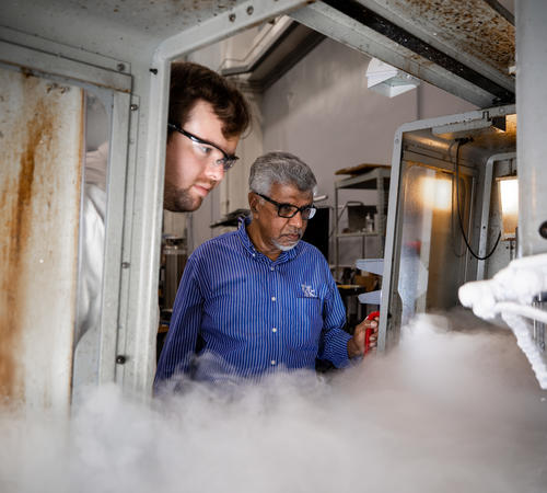 Professor I.S. Jawahir (right), conducting cryogenic material processing experiments with Daniel Caudill (left), Mechanical Engineering graduate research assistant. Pete Comparoni | UK Photo.