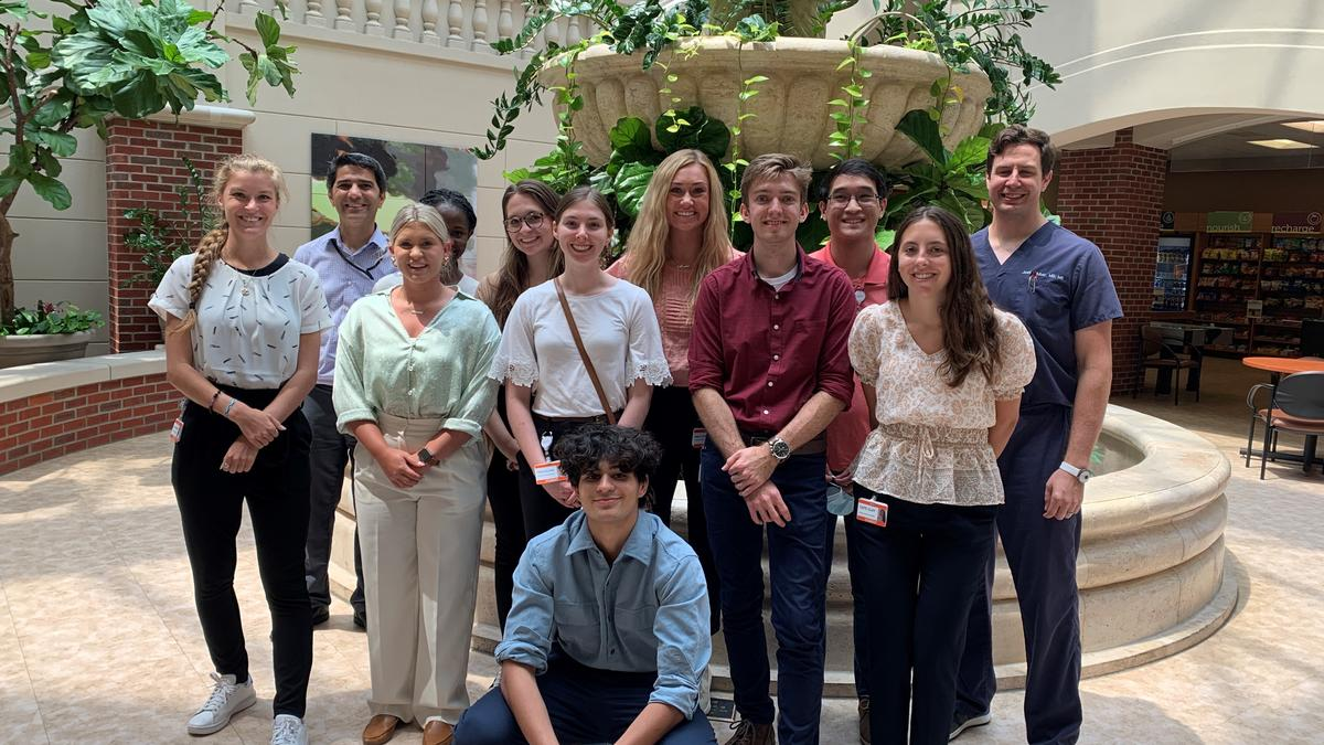 Group photo of summer clinical observational program participants and faculty