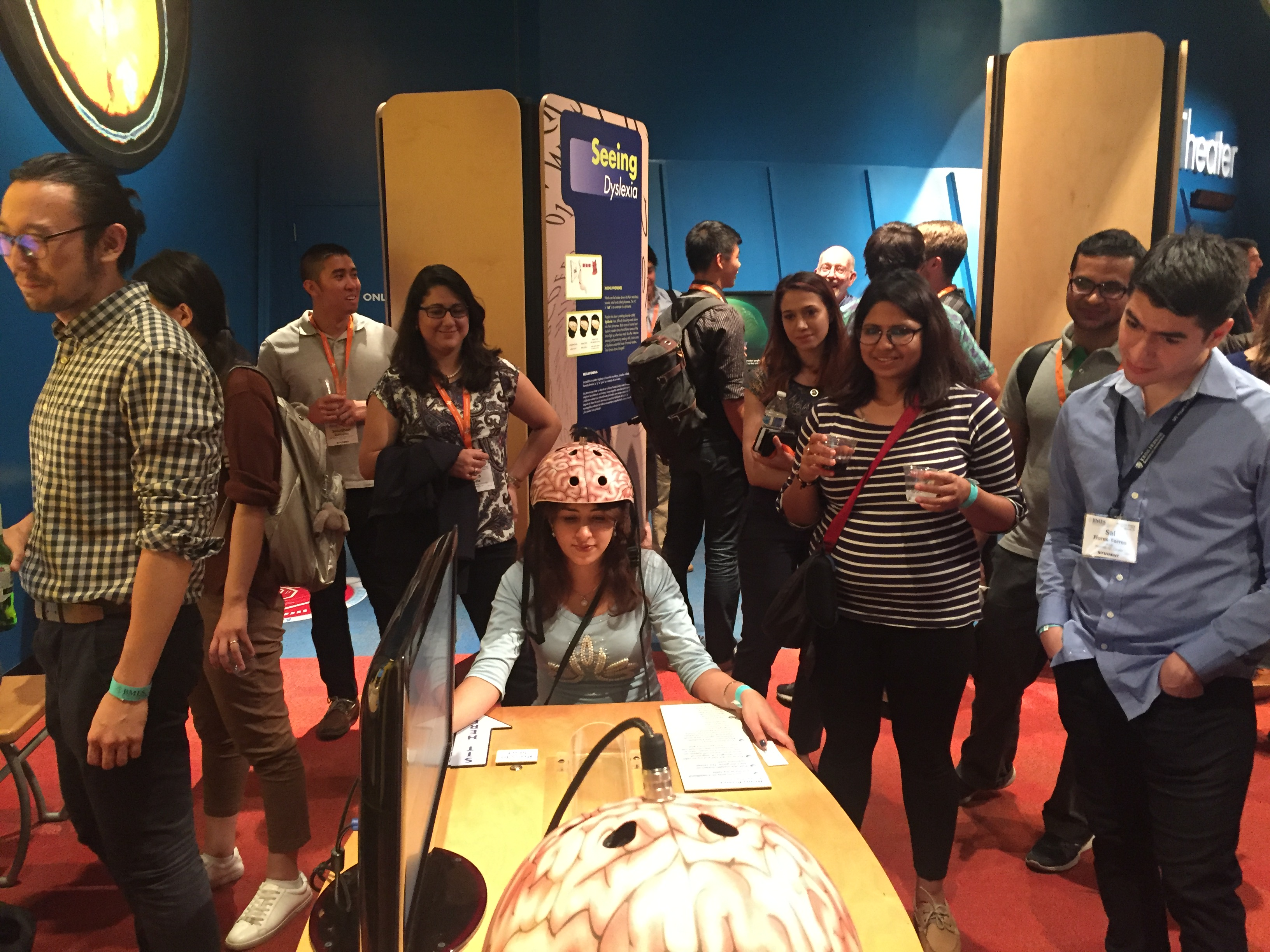 UK BMES member Sahar Alaei (center) practices her mind control skills during the BMES Dessert Bash at the Arizona Science Center.