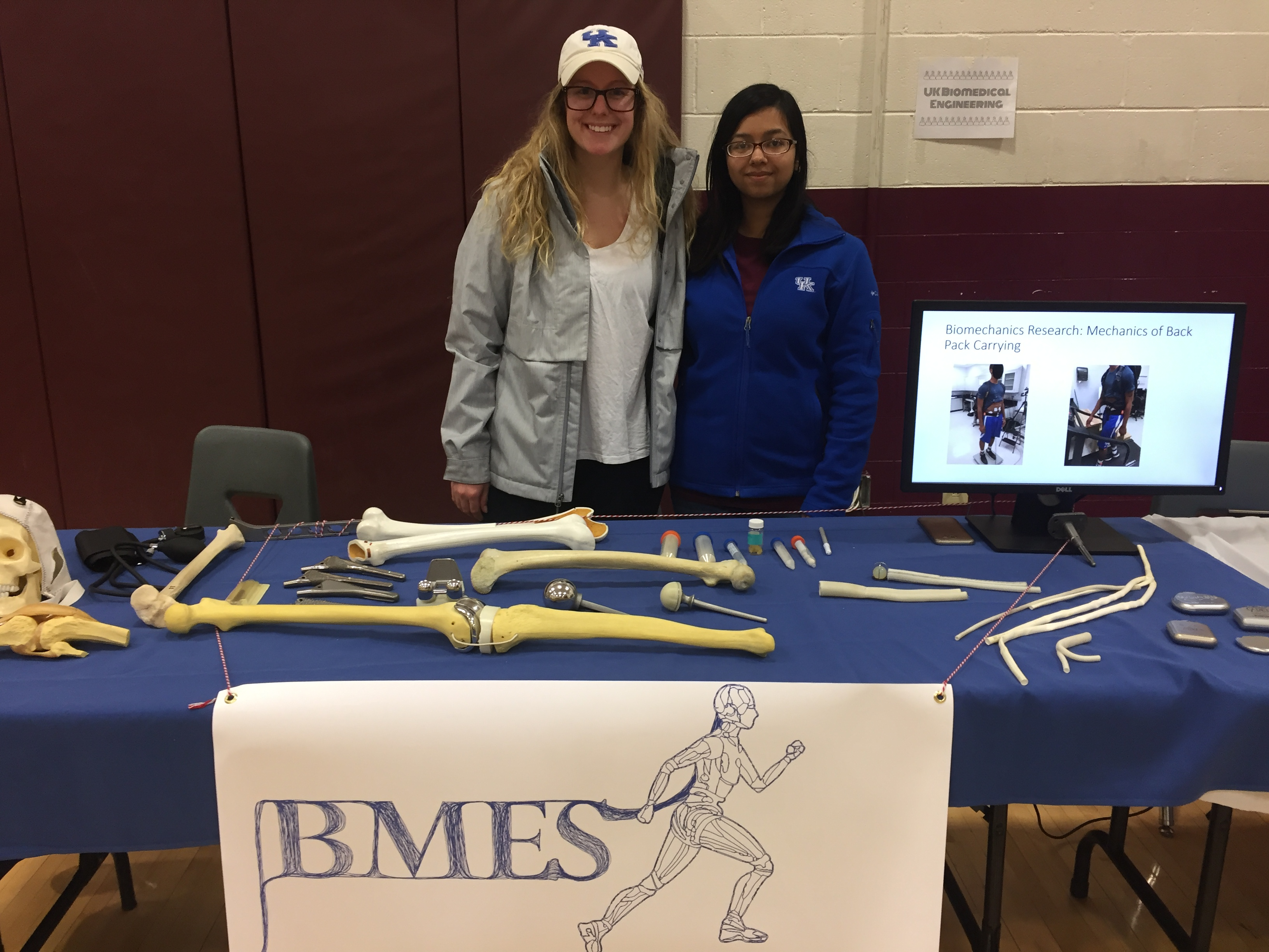 Lucy Niemeyer (left) and Tasneem Naheyan (right) behind the UK BMES Science Night booth at Leestown Middle School.