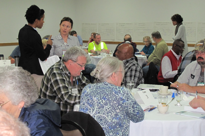 Attendees at a previous workshop work on issues such as operational optimization and resiliency, infrastructure stability, community sustainability and economic development, financial viability, and employee and leadership development.