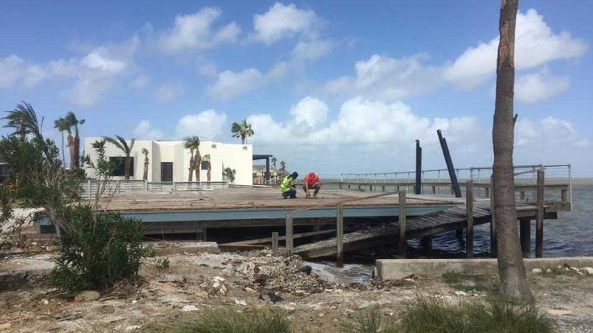 Workers assessing Harvey damage